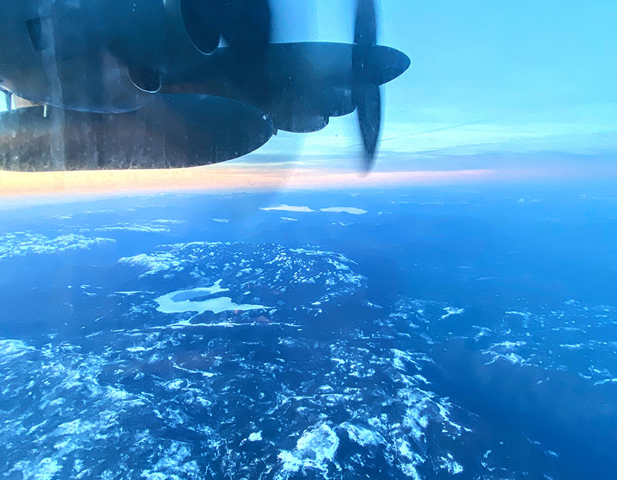 This is a picture of a C-130 aircraft flying a winter storm mission