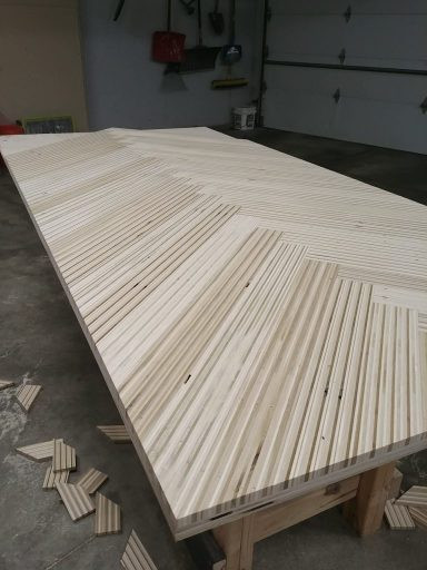 This is what the modern sliding barn door looked like before we put on hardware and after we cut off the plywood strip edges.