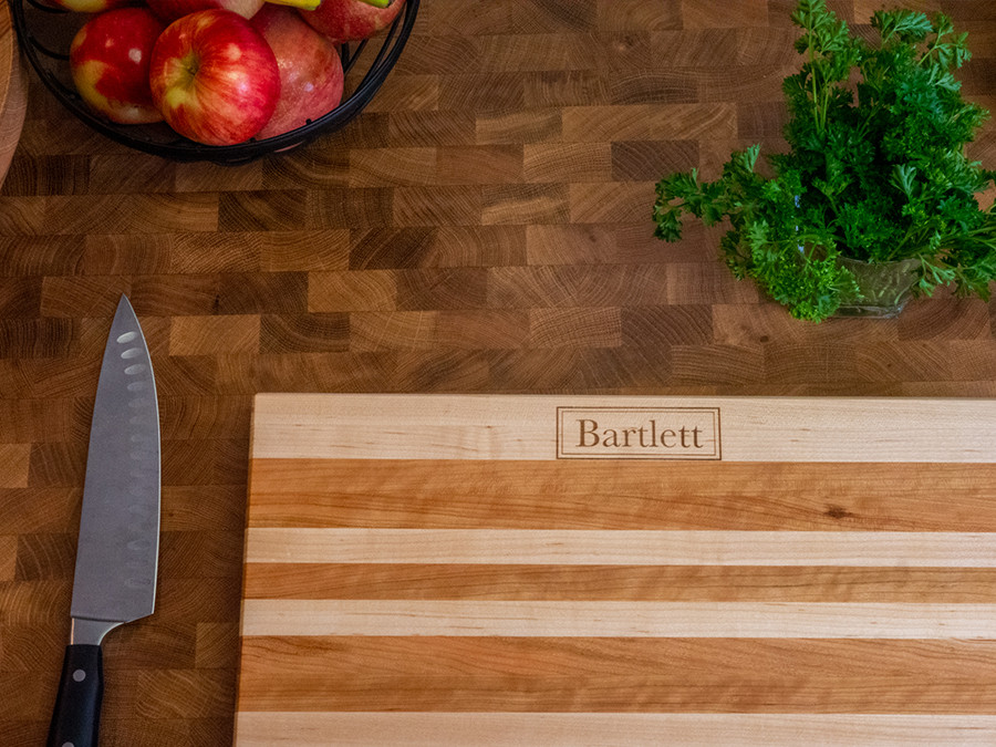 This is a custom engraved cutting board that we posted on our website and sold to a client.