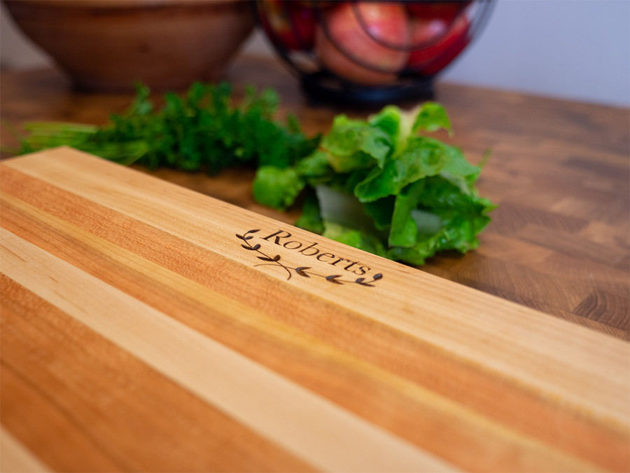 This is a solid wood cutting board that we created to sell in our business. We laser engraved the top with the client's last name.
