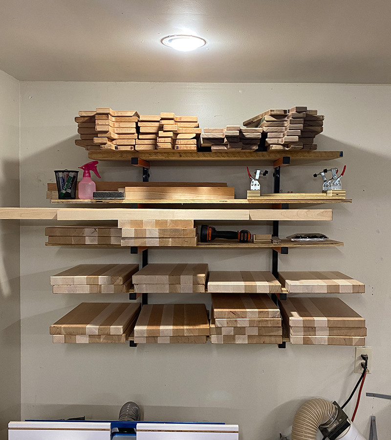 These are shelves with our finished cutting and charcuterie boards on them. They are ready to be sold.