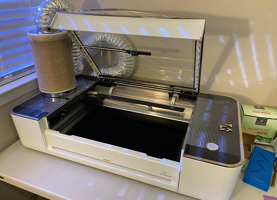 This is our Glowforge that we use to engrave cutting and charcuterie boards.