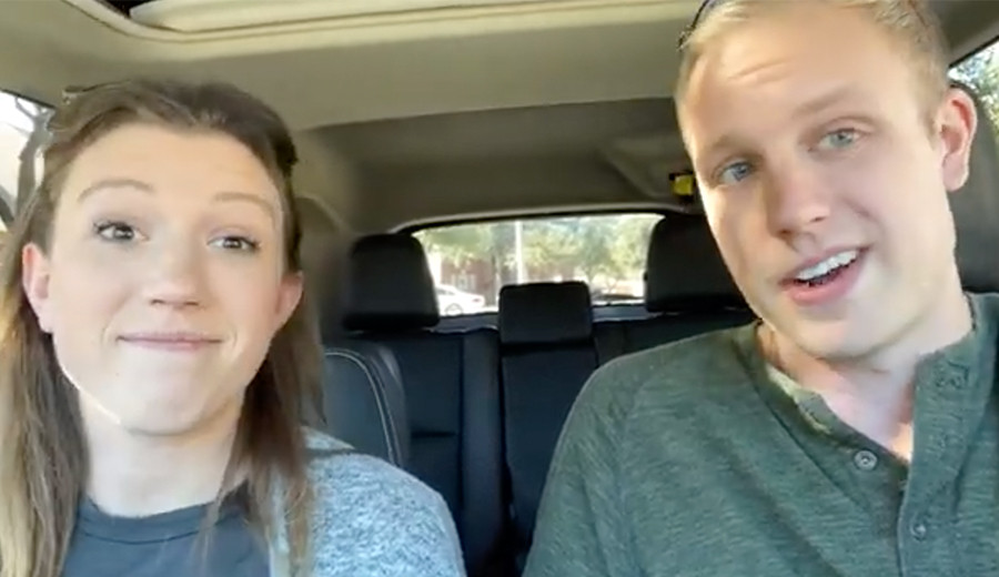 This is a picture of Jennie and Davis in the car before they went to sell a cutting board at their first realtor open house.