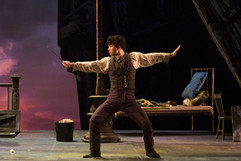 """La bohème The Glimmerglass Festival, 2016 Karli Cadel  """"Brian Vu plays Schaunard, the dancer.  Every time he enters, he grabs center stage, a true exhibitionist. In the boys' scene cavorting as dancers, he demonstrates he is the real thing. His is not just physical presence but vocal size and an irresistible ability to draw audiences into his character. His intelligent choices are seen throughout the production."""" - DC Theatre Scene"""