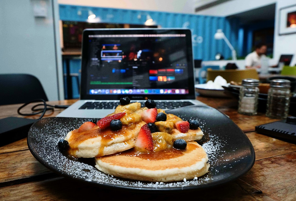 Working at ClubCo Singapore over a plate of Pancakes
