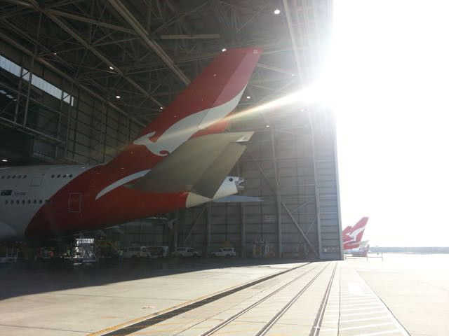 Qantas A380 tails sticking out from hangers in Sydney, Australia