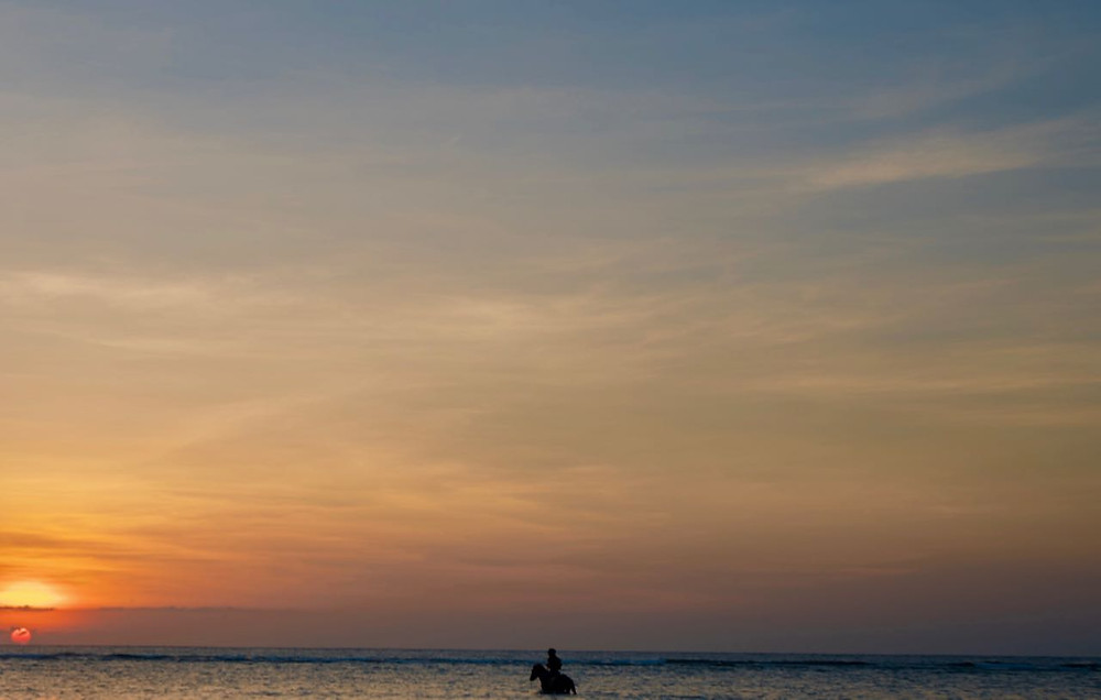 Horse riding into sunset Gili T island