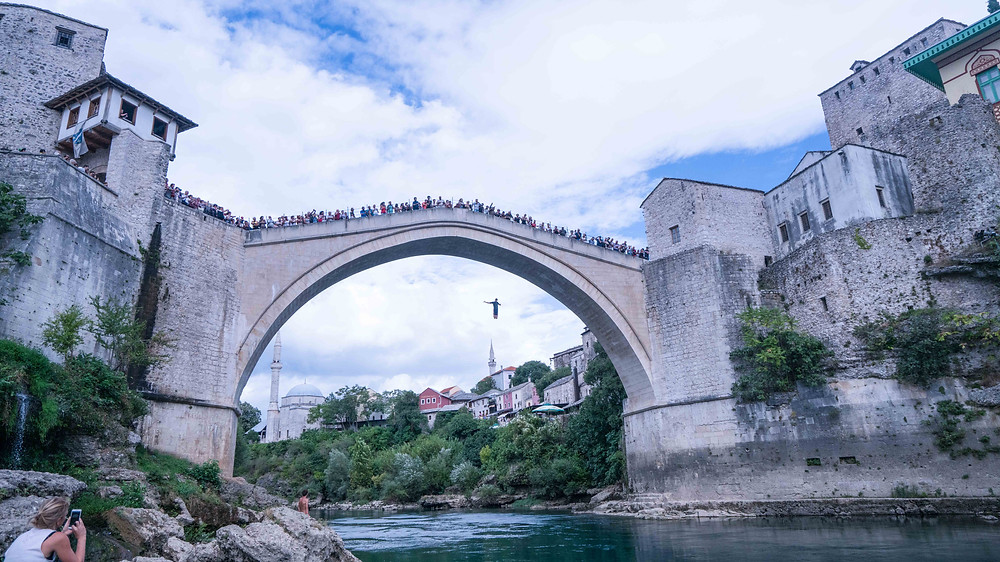Tourist jumping off Mostar Bridge