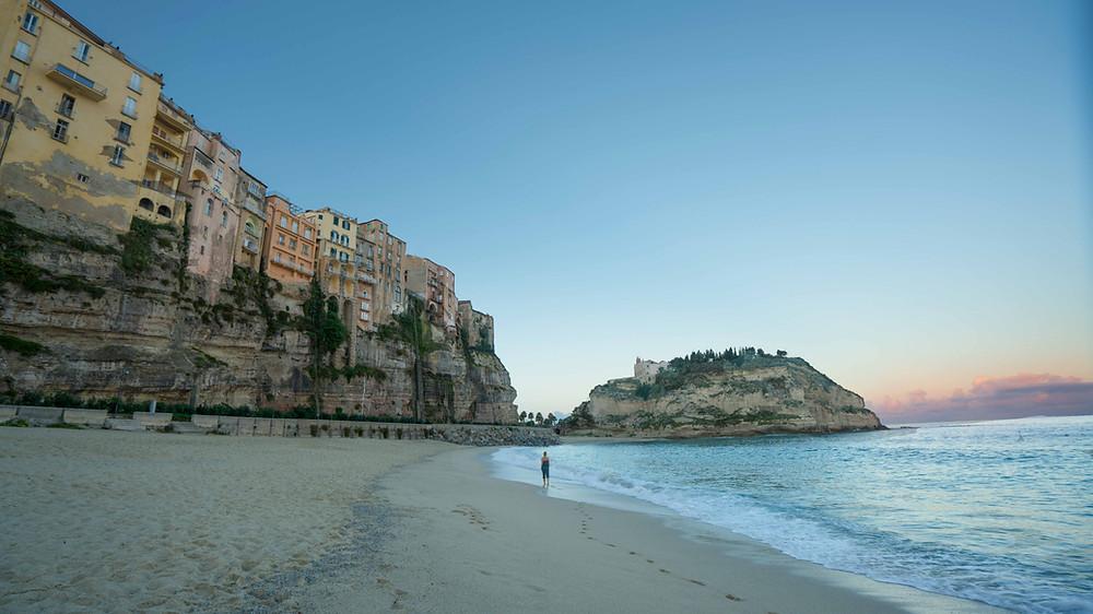 Walking along the cliffside beach in Tropea