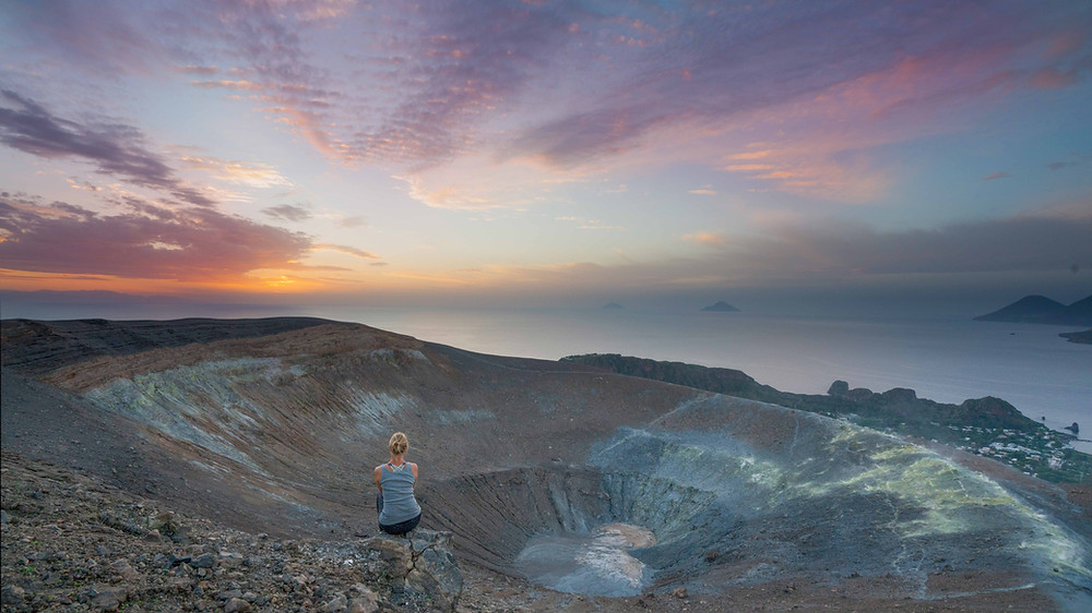 Watching sunset from the crater of Volcano