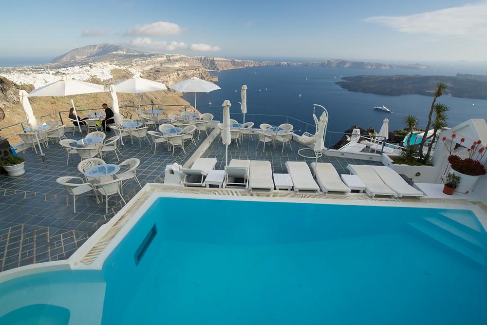 Swimming pool over cliff Santorini