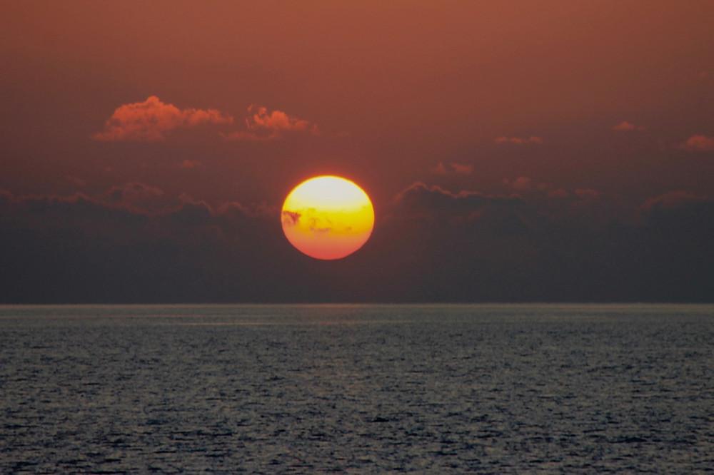 Huge sun in horizon from Kuredu Resort in the Maldives