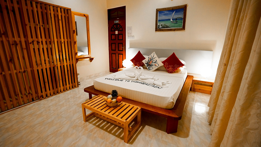 Thodhoo Island retreat bedroom on a local island in the Maldives