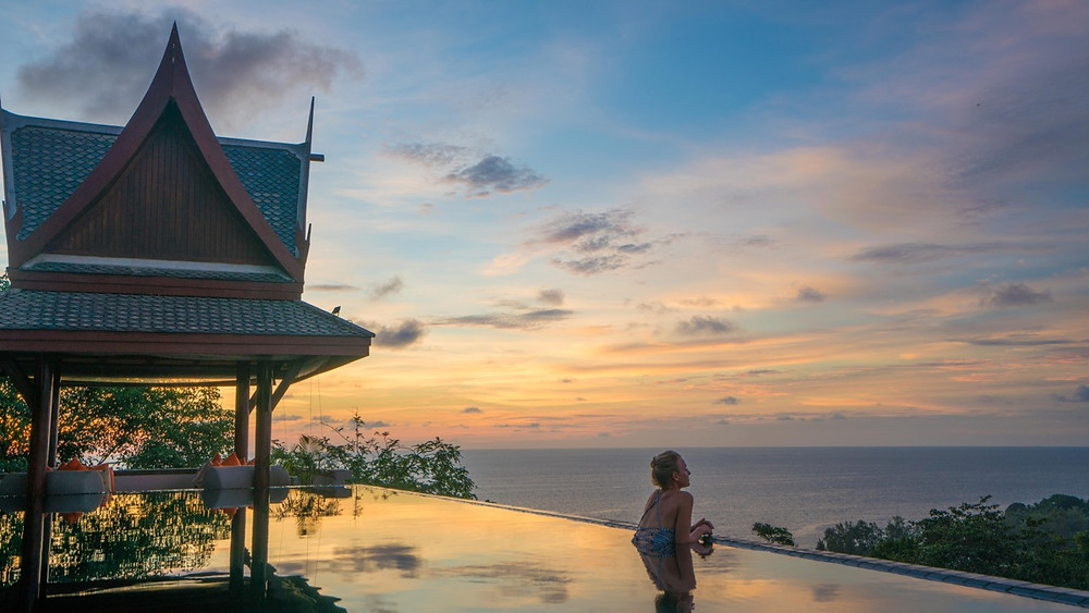 Baan Phu Prana rooftop pool at sunset