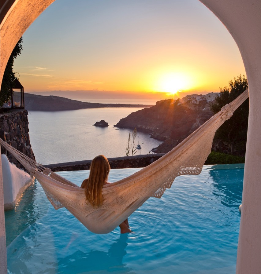 Hammock over pool overlooking the Island of Santorini and Ocean