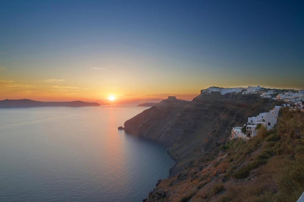 Sun sets over Santorini