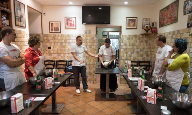 Rosario Piscopo and Giovanni Improta taking a pizza class