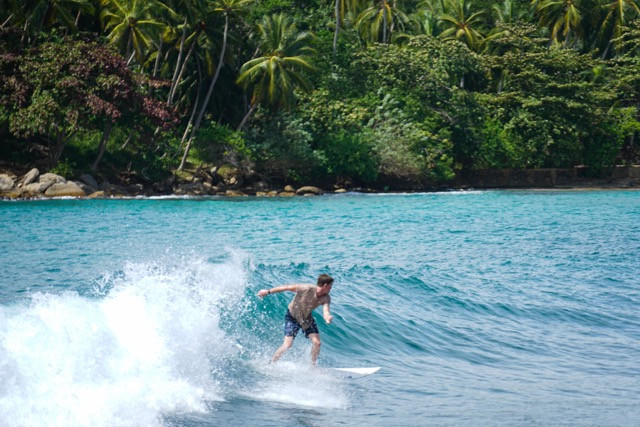 Surfing at Hirikitiya Beach, Sri Lanka