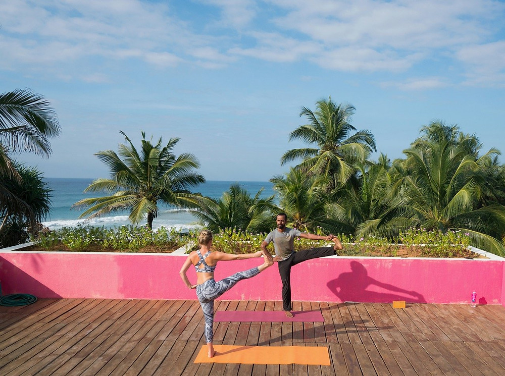 Morning yoga on a rooftop overlooking the Indian Ocean at UTMT resort