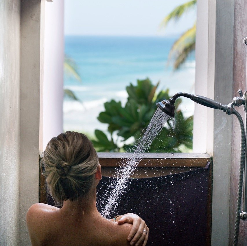 Open shower with view of Indian Ocean at UTMT Resort