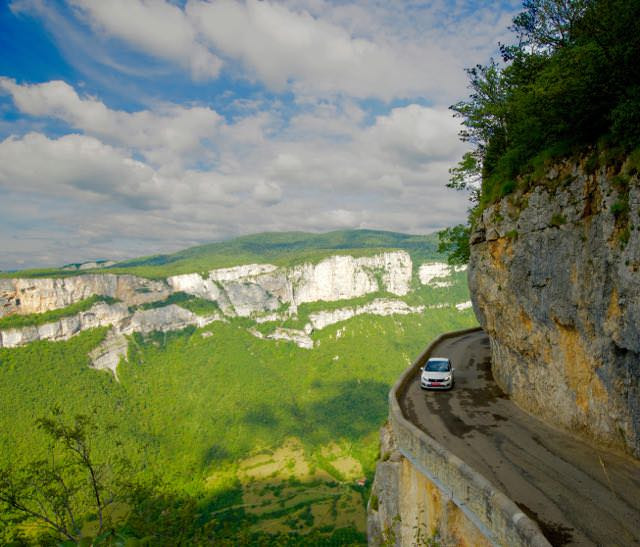 Driving along the cliffs of the Combe Laval Road