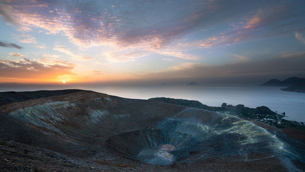 Huge active volcanic crater during sunset on the island of Vulcano