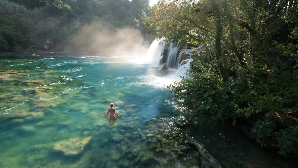 Swimming at the Kirka National Park waterfall