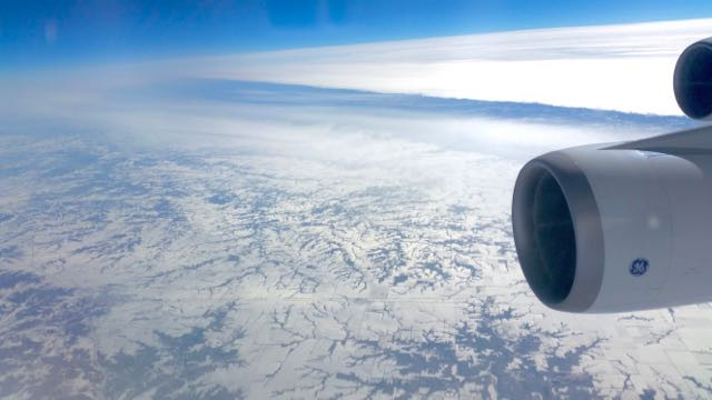 Boeing 747 Aircraft engines above frozen landscape on route to New York