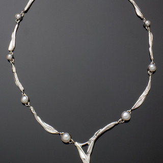 Sterling silver necklace with white and peacock pearls