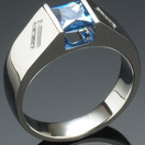 White gold ring with baguette diamonds and blue sapphire