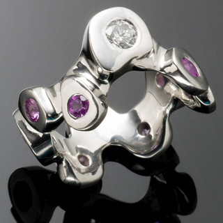 Platinum ring with diamond and pink sapphires
