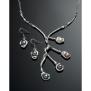 Sterling silver necklace and earrings with peacock pearls