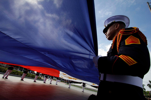 Soldiers practice raising the country's flag ahead of the nation's 119th Independence Day celebrations in Manila, June 11, 2017.