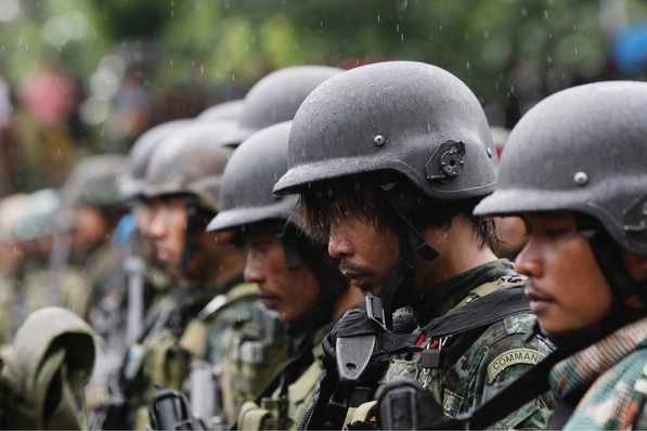 Members of the Philippine National Police Special Action Force who just arrived from Marawi, southern Philippines, bow their heads as they say a prayer for their fallen comrades during ceremonies at Camp Bagong Diwa, October 25, 2017. The Islamic State group sent at least $1.5 million to finance the recently ended siege of the southern Philippine city of Marawi, with the assault leaders using the 2014 IS seizure of the Iraqi city of Mosul as a blueprint, the Philippine military chief recently said.
