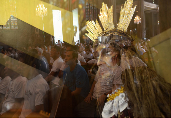 Taken with multiple exposure, an image of the Nazarene is merged with that of drug dependents who completed a one-year recovery program conducted under the Sanlakbay sa Pagbabagong Buhay program of the Diocese of Manila. Manila Archbishop Cardinal Luis Antonio Tagle officiated in the mass held Saturday to mark the graduation of the 132 former drug dependents from the program yesterday at the San Sebastian Church in Manila.