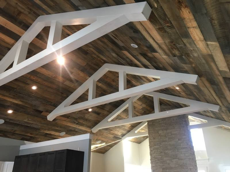 Use barn board to update those old ceilings from dull to shabby chic