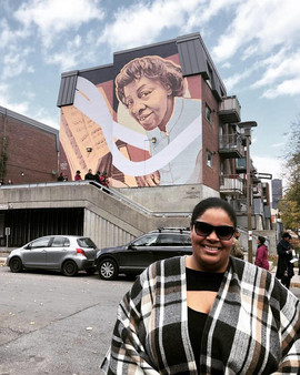 Céline after the unveiling of the mural for her late great Aunt, Daisy Peterson Sweeney. Created by Kevin Ledo & commission by MU. Photo by Jim Doxas