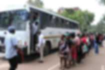 Bus passengers queue commuters