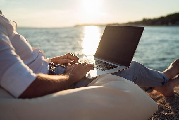 Senior man working on his laptop on the