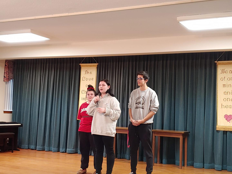 Tri M members emceeing at local Convent
