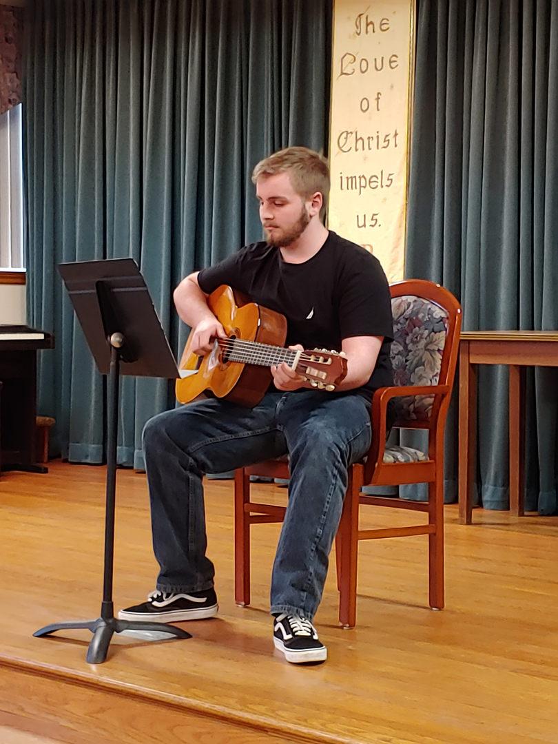 Tri M member performing at local Convent