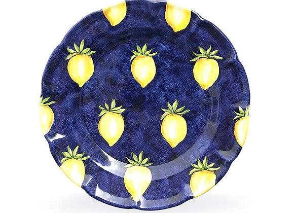 Piatto blu con pomodoro giallo