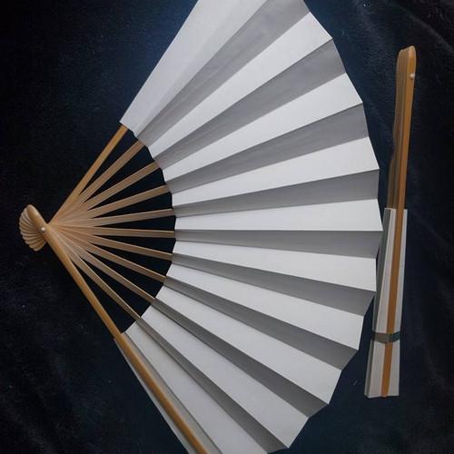 2 white folding fans