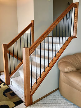Stair handrail oak After picture Brandon MB interior finishing