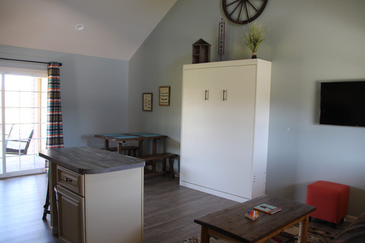 Murphy bed, kitchen bar, table and chairs