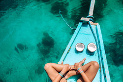 Young girl relaxing on the boat and eati