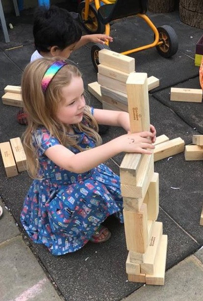 giant jenga towers in the garden