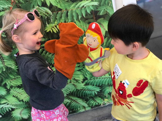 role play with puppets in the garden to practise communation and have lots of fun with friends
