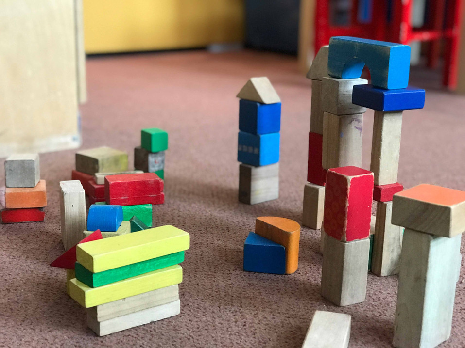 When we use our wooden bricks we learn loads about shapes, numbers and the physics of construction!