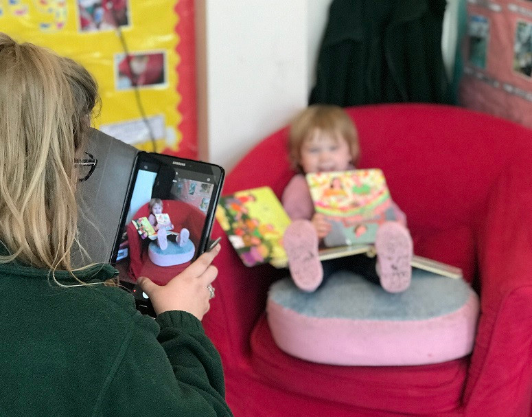 catching important moments such as children reading on tablet